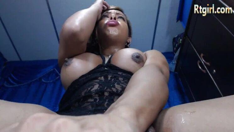 Pretty busty black tranny haning an incredible masturbation