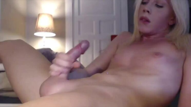 Comely golden-haired young harlot is making him cum