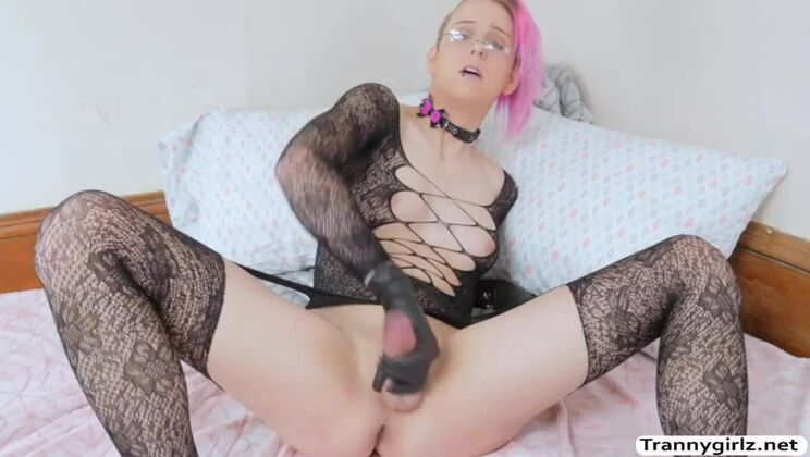 Enticing tattooed tranny in lingerie porn video